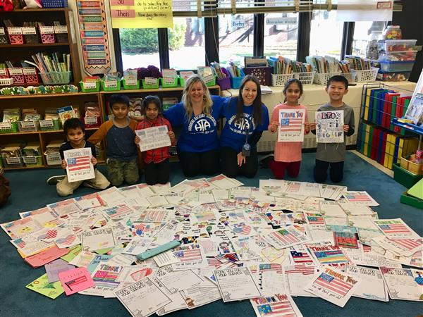 Denton students pose with their thank you cards for the Veterans.