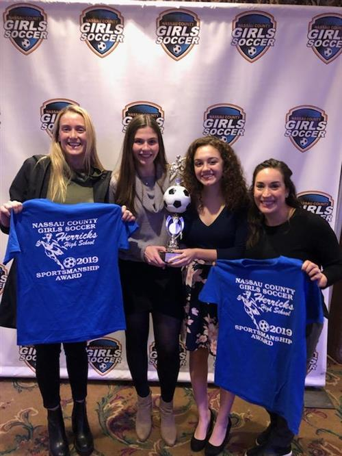 Herricks Girls Soccer Team Accepts Nassau County Referees Sportsmanship Award